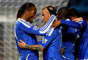 Raul Meireles celebrates with Didier Drogba after scoring a goal