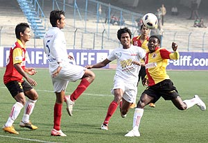 East Bengal players in action with Pailan Arrows' players