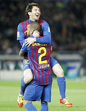 Barcelona's Lionel Messi and Dani Alves celebrate after winning the Club World Cup final against Santos