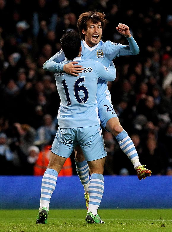 Manchester City's David Silva celebrates with teammate Sergio Aguero (left) after scoring on Sunday