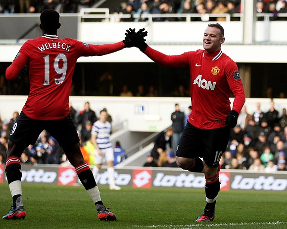 Wayne Rooney (right) celebrates with teammate Danny Welbeck after against QPR