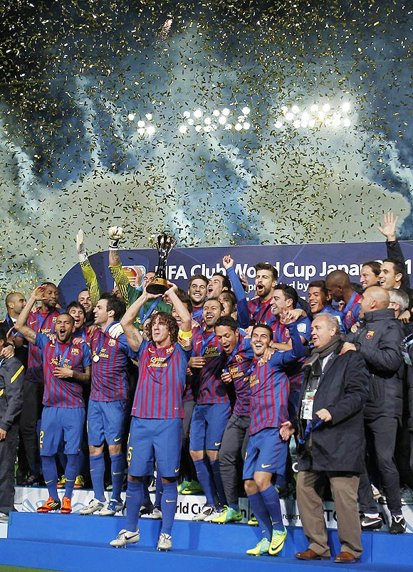 Spain's Barcelona players celebrate on the podium after they beat Brazil's Santos to win the Club World Cup final on Sunday