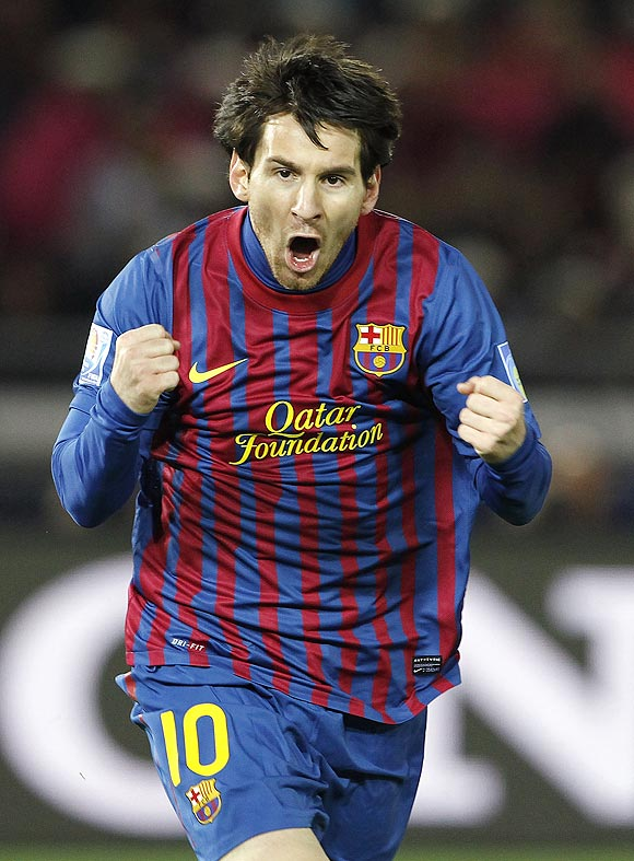 Lionel Messi celebrates after scoring the first goal against Santos