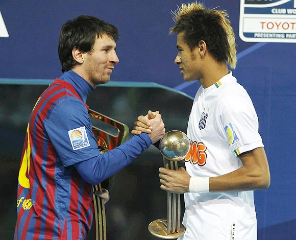 Lionel Messi (left) and Neymar greet each other after their Club World Cup final