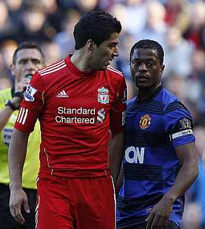 Luis Suarez and Patrice Evra in a confrontation