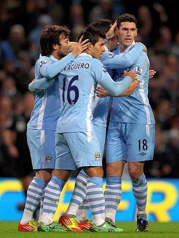 Manchester City's Sergio Auguero celebrates after scoring against Stoke City