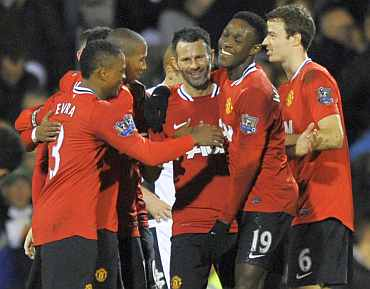 Manchester United's Ryan Giggs celebrates with teammates