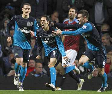 Arsenal's Yossi Benayoun celebrates after scoring