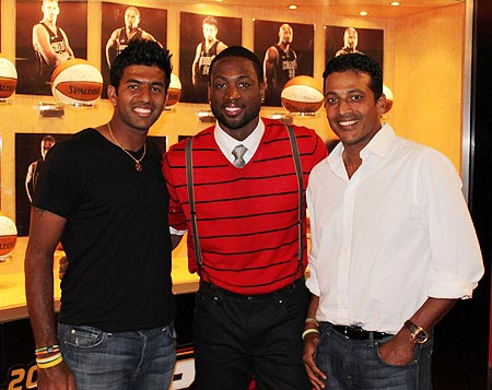 Rohan Bopanna (left) and Mahesh Bhupathi with NBA star Dwayne Wade