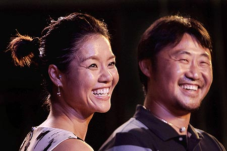 French Open champion Li Na (left) and her husband Jiang Shan