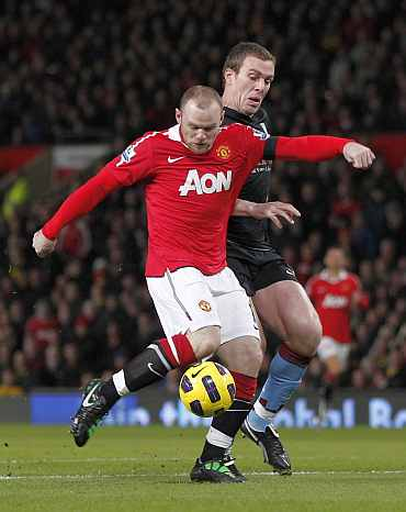 Wayne Rooney shoots during an English Premier Leage match against Aston Villa on Tuesday