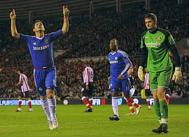 Frank Lampard celebrates after scoring a penalty during his match against Sunderland