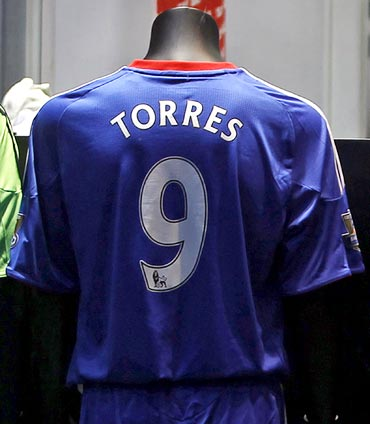 Chelsea soccer strip of the club's new signing, Fernando Torres, is displayed in the club shop at Stamford Bridge in London