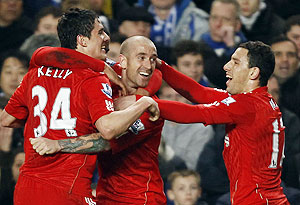 Liverpool's Raul Meireles (centre) celebrates with team-mates after scoring against Chelsea on Sunday