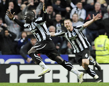 Newcastle United's Cheik Tiote (left) celebrates scoring against Arsenal on Saturday