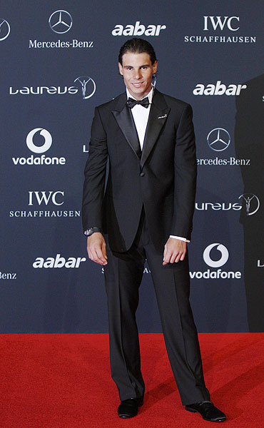 Rafael Nadal poses on the red carpet at the Laureus World Sports Awards in Abu Dhabi on Monday