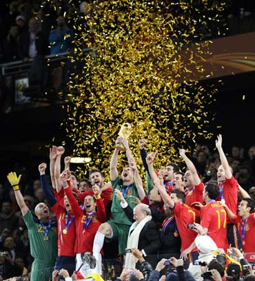 Spanish players celebrate after winning the World Cup