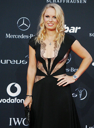 Danish tennis star Caroline Wozniacki poses on the red carpet as she arrives for the Laureus World Sports Awards in Abu Dhabi on Monday