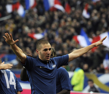 France's Karim Benzema reacts after scoring goal against Brazil