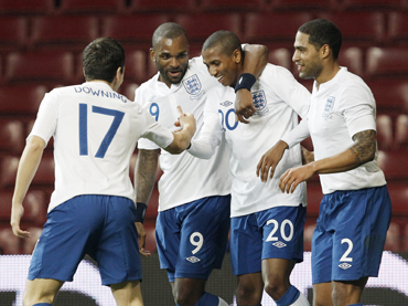 England 's Ashley Young (2nd R) celebrates after scoring against Denmark during their international friendly soccer match at the Parken Stadium, in Copenhagen