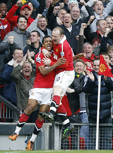 Nani celebrates with Wayne Rooney (right) after scoring against Man City