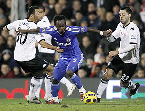 Chelsea's Michael Essien (centre) is challenged by Fulham's Moussa Dembele (left) and Clint Dempsey during their EPL match at Craven Cottage in London on Monday