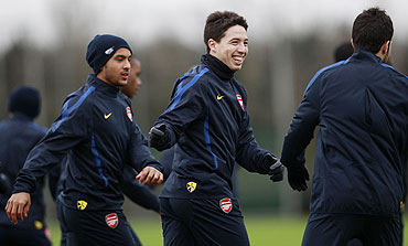 Arsenal's Samir Nasri (centre), Cesc Fabregas (right) and Theo Walcott attend a team training session in London Colney on Tuesday