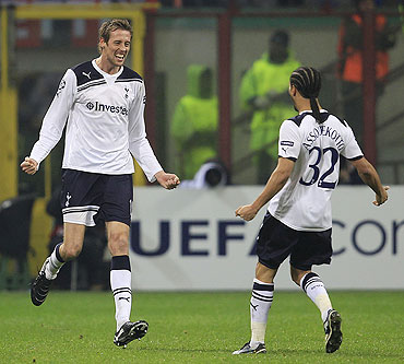 Tottenham Hotspur's Peter Crouch (left) celebrates with teammate Benoit Assou-Ekotto after scoring against AC Milan on Tuesday