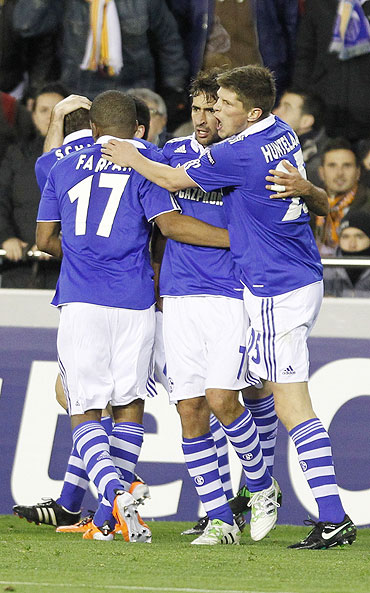 Schalke 04's Raul Gonzalez (centre) celebrates with teammates Klaas-Jan Huntelaar (right) and Jefferson Farfan after scoring against Valencia on Tuesday