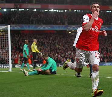Arsenal's Robin van Persie celebrates after scoring against Barcelona during their Champions League match