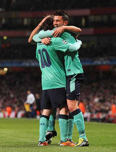 Barcelona's David Villa celebrates with Lionel Messi during his match against Arsenal at the Emirates