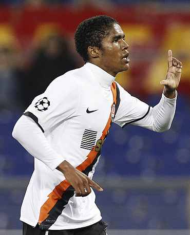 Shakhtar Donetsk's Douglas Costa celebrates after scoring against AS Roma during their Champions League match at the Olympic stadium