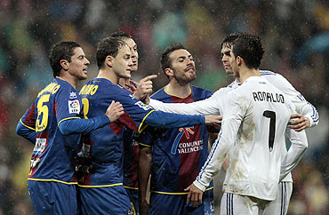 Levante's Asier del Horno (left), Victoriano Rivas, Sergio Ballesteros and Xavier Torres argue with Real Madrid's Cristiano Ronaldo (right) as Kaka tries to seperate them during their La Liga match at Santiago Bernabeu in Madrid on Saturday