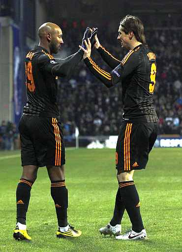 Chelsea's Nicolas Anelka (L) celebrates with team-mate Fernando Torres after scoring his second goal aginst FC Copenhagen during their Champions League match