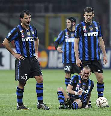 Inter Milan's (from L) Dejan Stankovic, Cristian Chivu, Wesley Schneider and Thiago Motta react during their Champions League match against Bayern Munich