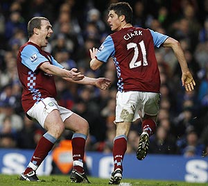 Aston Villa's Richard Dunne is ecstatic after teammate Ciaran Clark (right) scored the injury-time equaliser against Chelsea on Sunday