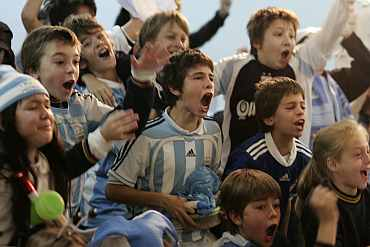 Children watching a match in Argentina.