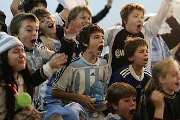 Children watching a match in Argentina.