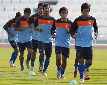 Indian players practice during a warmup session at Al Wakrah Stadium in Doha