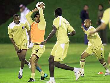 Qatar players play during a warm up session in Doha