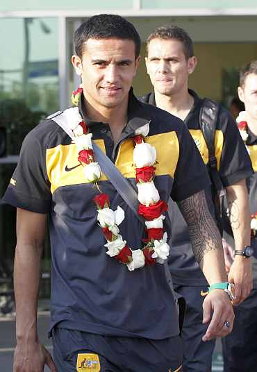 Australia's TIm Cahill arrive at the Doha International Airport