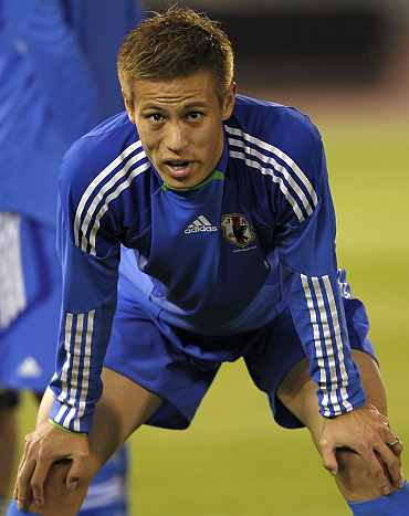Keisuke Honda during a training session in Doha