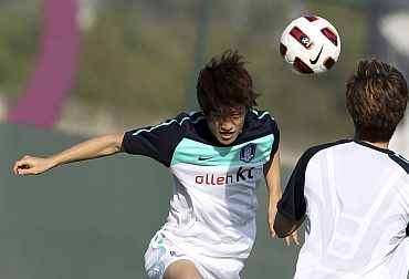 South Korea's Lee Chung-young heads the ball during a training session ahead of the Asian Cup