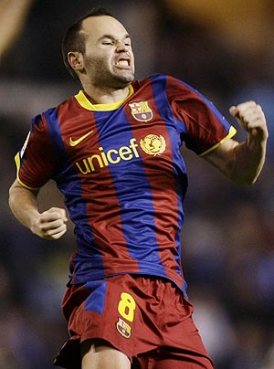 Barcelona's Andres Iniesta celebrates his goal against Deportivo Coruna