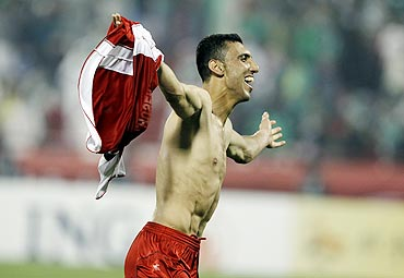Syria's Abdulrazak Al Husein celebrates after defeating Saudi Arabia on Sunday
