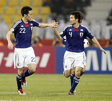 Japan's Maya Yoshida (left) celebrates his goal against Jordan with teammate Yasuyuki Konno