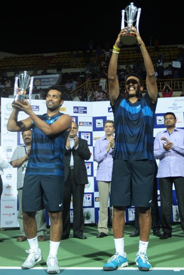 Paes and Bhupathi with the Chennai Open trophy