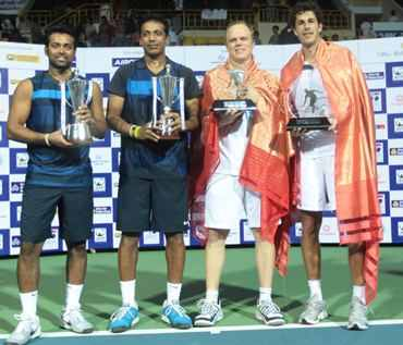 Leander Paes and Mahesh Bhupathi with the Chennai Open trophy