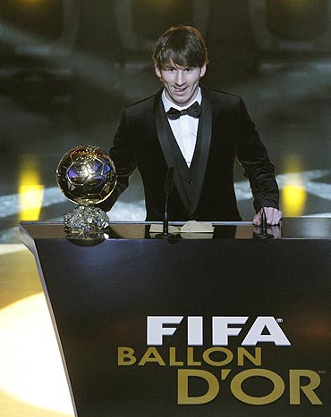 Lionel Messi gives a speech after receiving his trophy