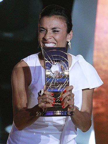 Marta of Brazil, FIFA Women's World Player 2010 holds the FIFA Ballon d'Or 2010 trophy